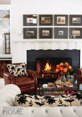 Heirloom lithographs depicting farm scenes hang above the study's fireplace.
