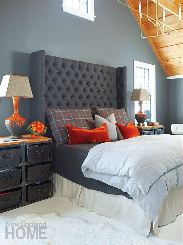 Dragoo designed the tufted headboard in the cozy master bedroom.