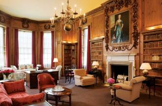 The library's high-relief over-mantel carvings date back to the late-seventeenth century.