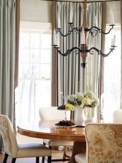 The family often dines at the kitchen table, where large windows overlook the New Canaan Reservoir beyond.