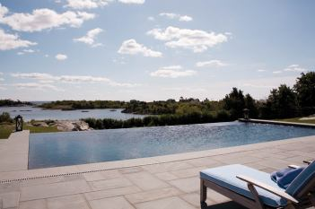 The pool looks out on quiet cove.
