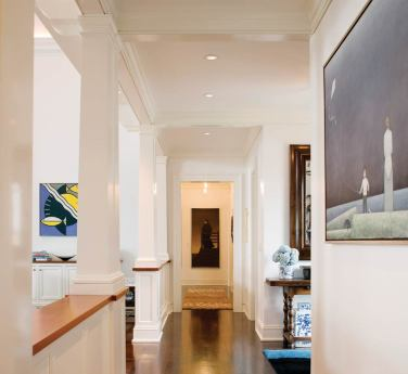 The owner's art collection stands out on white wall sin the foyer and throughout the house.