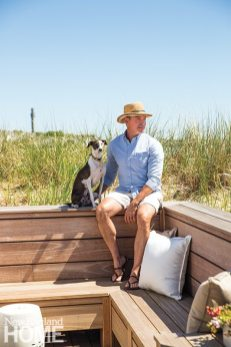 Dominic takes in the coastal view with his dog, King.