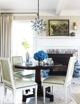 Although small in scale, the dining table can still comfortably seat six for a dinner party.