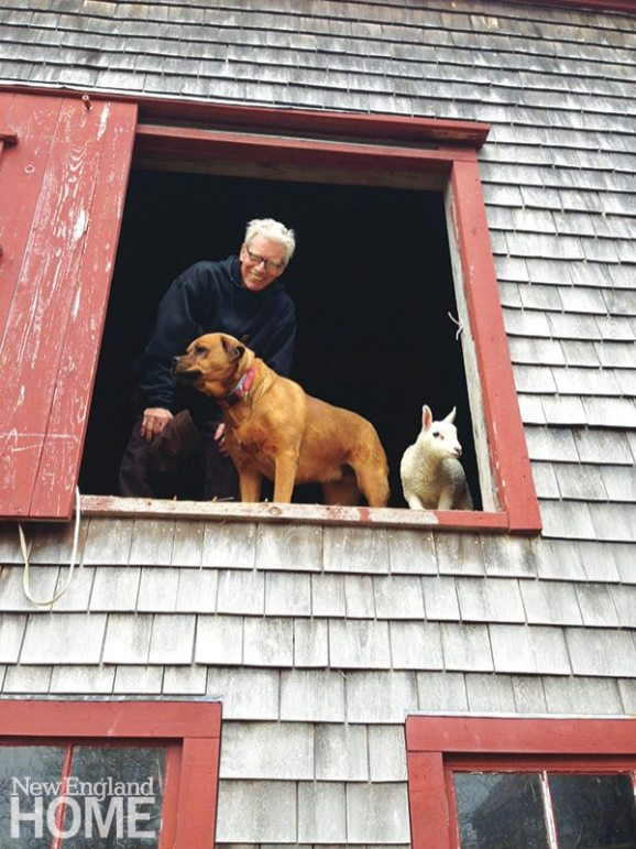 The artist with a pair of four-legged friends.