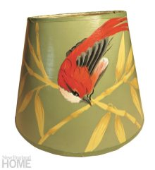 A hand-painted songbird and branches on a foil background offer a touch of the Orient.