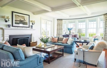 Lovely millwork and quietly elegant furnishings in the living room mesh, providing a setting that's both comfortable and beautiful.