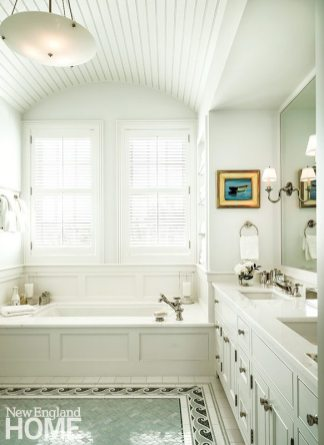 A vaulted ceiling above the tub in the master bath is one more example of the skillful architects' attention to details. Open shelves house towels, and marble in the tub surround and counter lends a note of elegance.