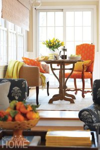 Susie's favorite shade-orange-adds a zesty note to a sitting nook at one end of the kitchen.