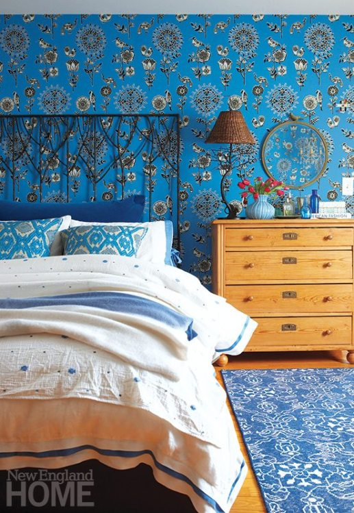 Damask wallpaper in a rich shade of blue sparked the plan for the daughter's room.