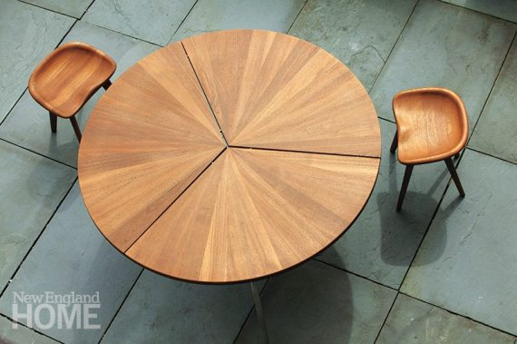 Solid wedges of teak form the top of the Circular Dining Table