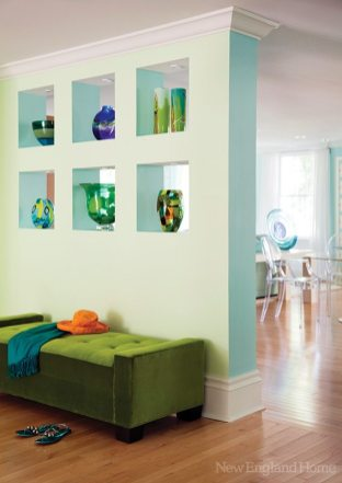 Ouellette's collection of art glass is housed in specially designed wall niches.