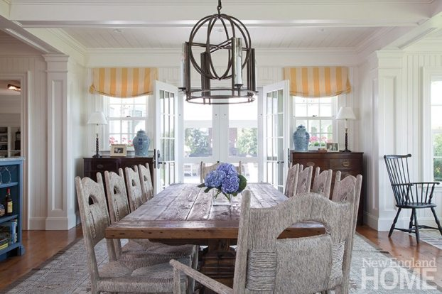 The dining area's decor incorporates a stalwart lantern by Formations and a pair of antique chests.