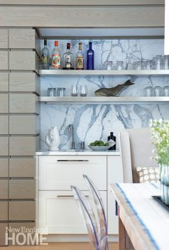 Built-ins, like the statuario-marble-backed wet bar, add luxury without taking up valuable space.
