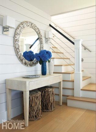 An oyster-shell mirror and faux-crocodile desk add visual interest to the entry way.