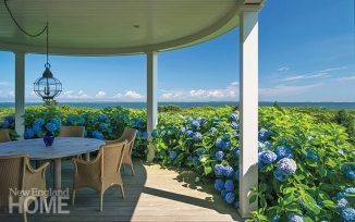 Masses of purple hydrangea envelop the deck's dining area in the round.