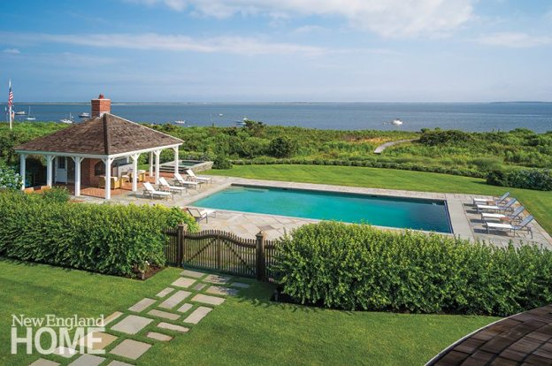 The pool was an integral part of the site plan, but the homeowners insisted on a simple stone surround.
