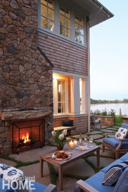 Another terrace DaSilva created along with landscape architect David Hawk emphasizes the cozy fireplace.