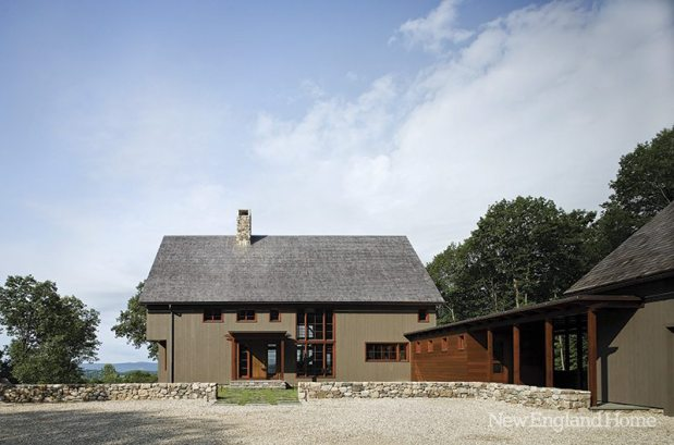 """The new home's shape says """"barn""""; while fenestration and amenities speak of the comforts of modern life."""