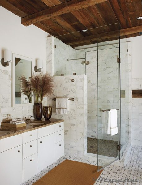 Beneath the ancient beams: a gleaming white marble bath.