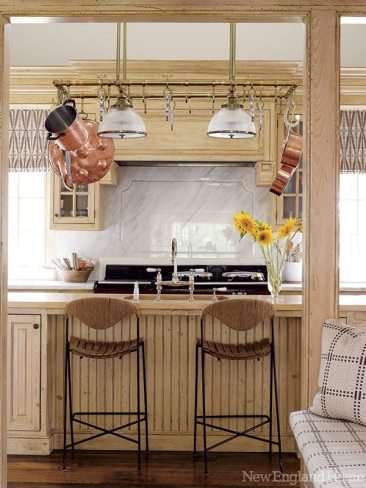 The kitchen needed little more than new light fixtures to freshen it up.