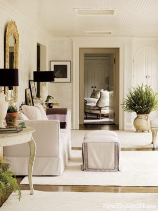 The garden room adds hints of pale lavender and green to the gray that unites the first-floor rooms.