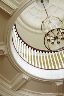 Architectural details, like the coffered ceilings, abound throughout.