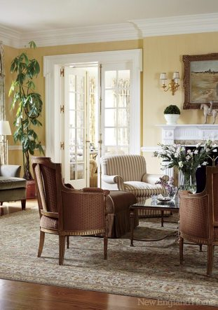 A sitting area surrounds an antique mantel in the living room.