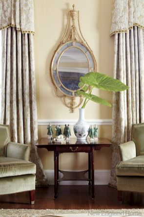 The palette is intentionally neutral, providing contrast for curvaceous seating and richly textured accessories.