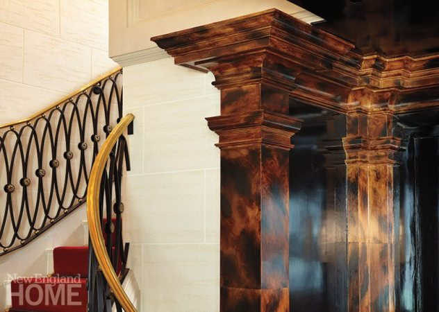 Columns wearing a faux giant-tortoiseshell glaze stand against faux travertine walls.