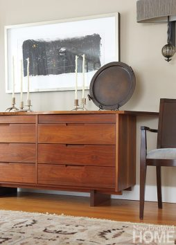 A Robert Motherwell lithograph hangs above the Nakashima sideboard.