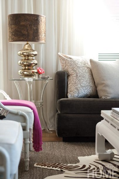 Metallic and organic mix in the living room's mercury-glass lamp with cork lampshade.