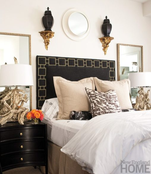 Driftwood lamps and a hide pillow lend an organic touch to the custom headboard and nightstands in the master bedroom.