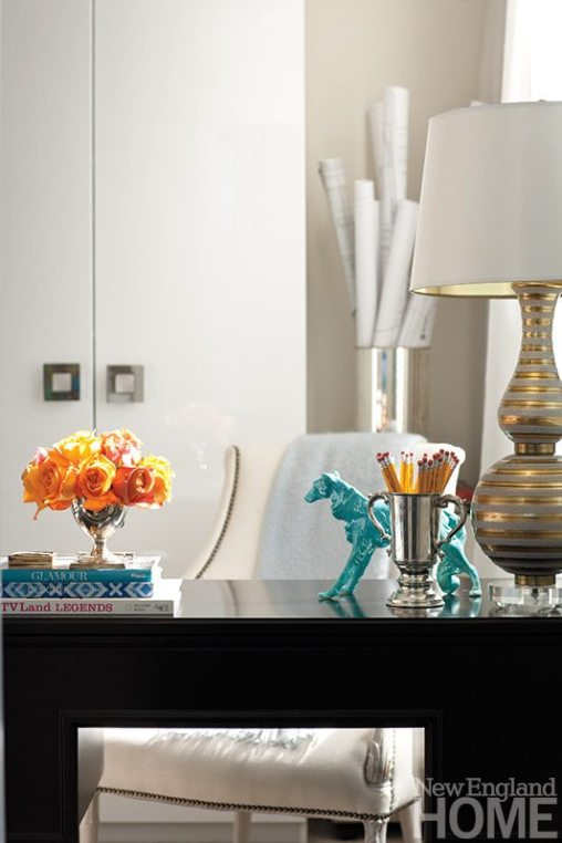 Silver and gold touches give the small office a layer of glamour.