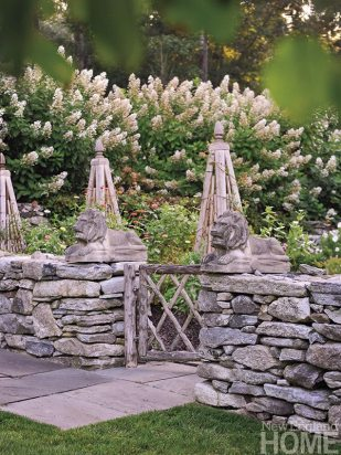 Obelisks invite flowering vines and create focal points in the wife's picking garden.