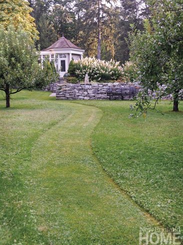 Designer Sandra Visnapuu mowed a path through the apple trees to create a marvelous fairytale-like scene. The path leads to the picking garden and up the steps to the orangery located at the back of the house.