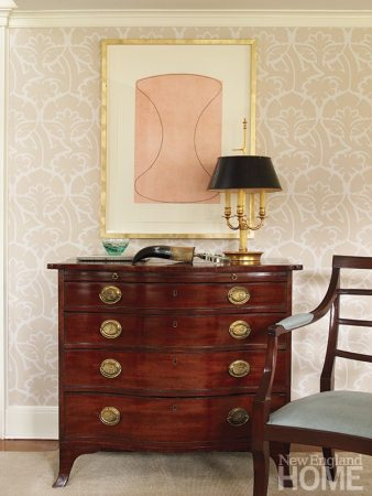 A Robert Mangold print and an antique Federal chest marry happily in the sitting room.