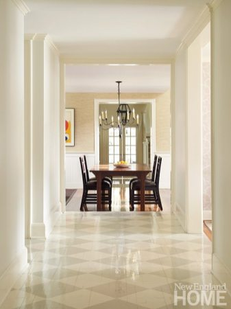 The hallway was given a decorated floor to dispel its formerly dark state.