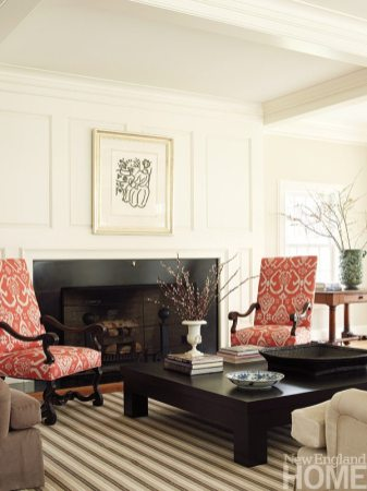 The sunny family room with its coffered ceiling and paneled hearth is the owners' favorite destination for kicking back.