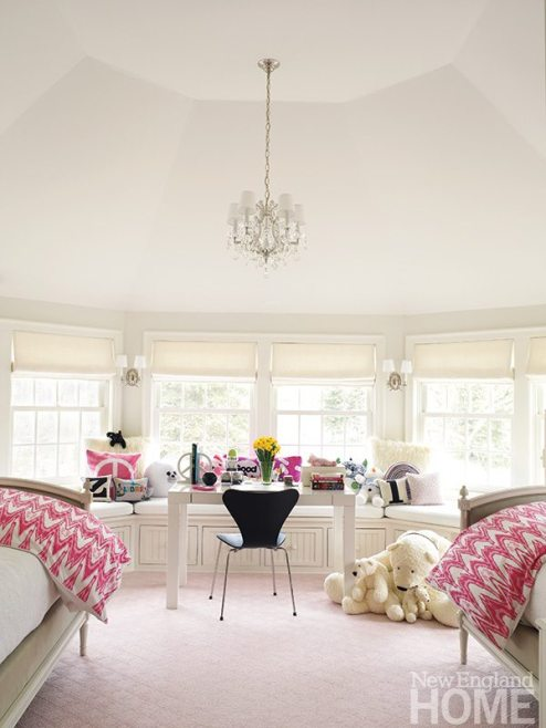 A pale-pink carpet and a window seat wrapped in Ultrasuede make the daughter's room extra special.