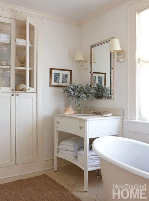 The curved fronts of the master bathroom's vanities make it easy to lean into the mirror while shaving or applying makeup.
