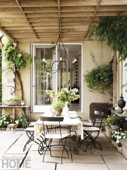 Filled with greenery, a dining alcove on the patio radiates European charm.
