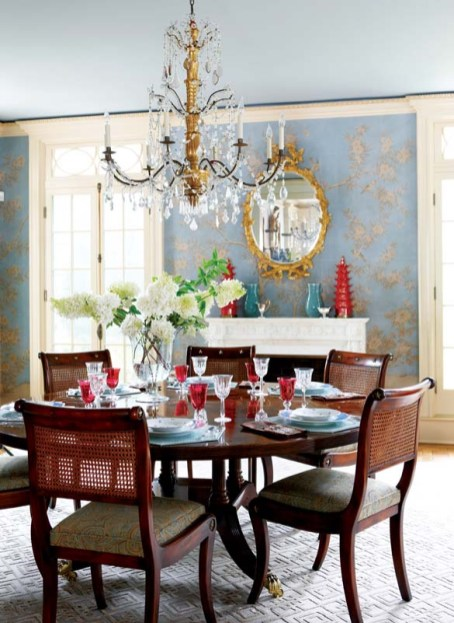 A trellis-patterned rug warms the dining room.