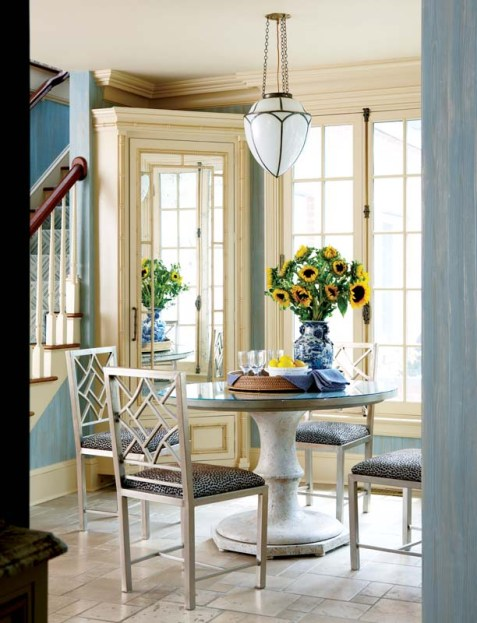 This pretty auxiliary space just off the kitchen serves for breakfast or kids' craft time.