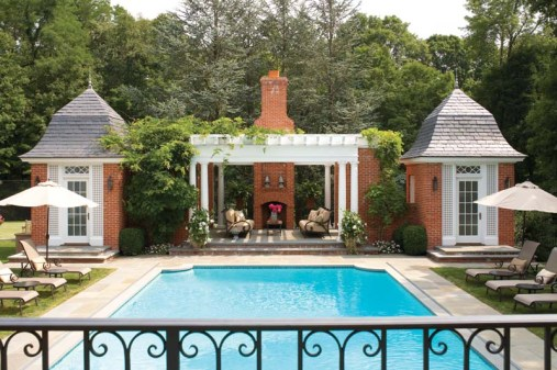 A new outdoor hearth and pergola frame the pool-side sitting area.