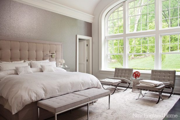 Barcelona chairs and upholstered Midcentury benches add verve to a serene master bedroom.