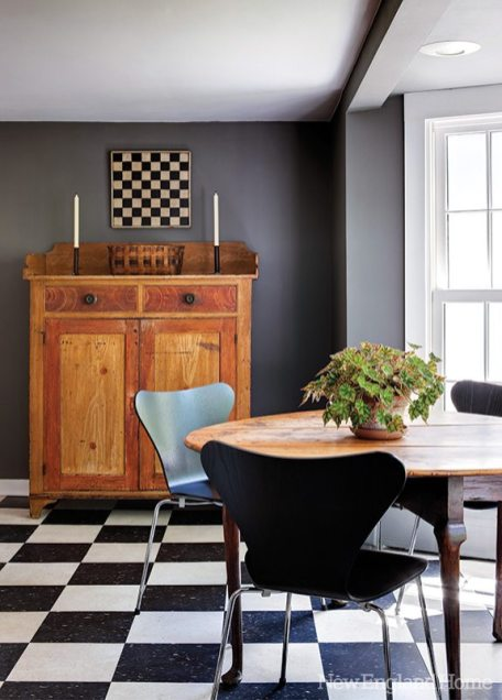 An antique game board echoes the kitchen floor.