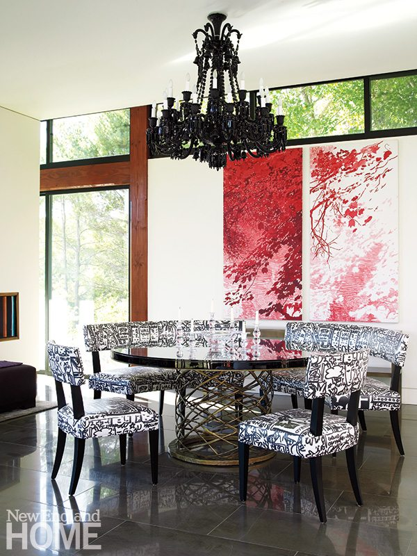 An artful bronze-base table and a Baccarat chandelier lend drama to the breakfast area, where clerestory windows pull in additional light.