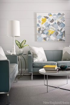 Gray leather sofas invite relaxing in the TV room.