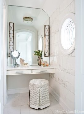 Faux Carrara wall and floor tile wraps the master bathroom.